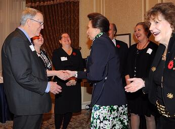 Malcolm shaking hands with Princess Ann