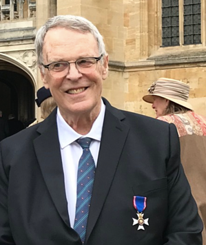 Malcolm with his medal from the Queen