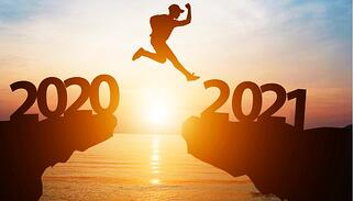 silhouette-man-jump-from-2020-to-2021-on-cliff-with-sunlight-for-and-picture-id1269824130 (1)